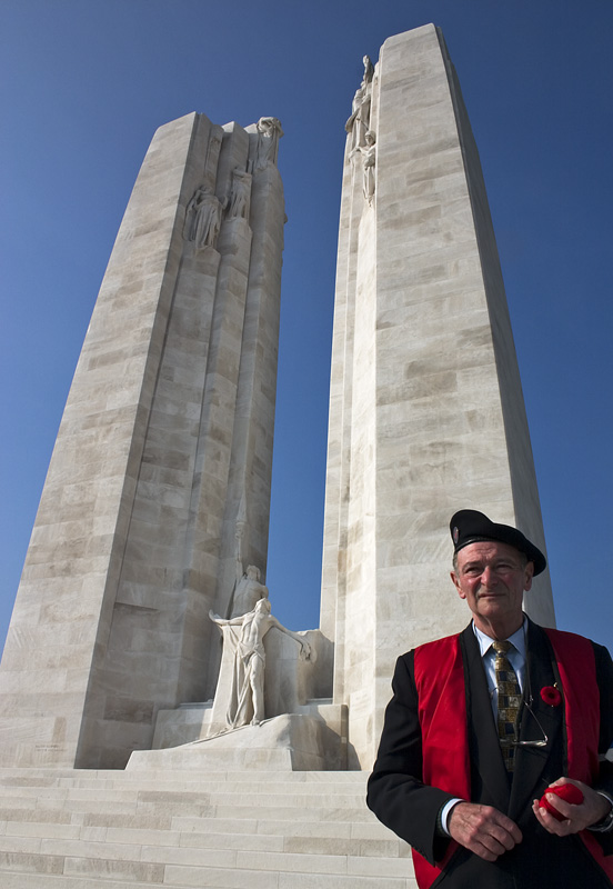 A Handful of Poppies; a French Veteran in front of the two pylons representing Canada and France