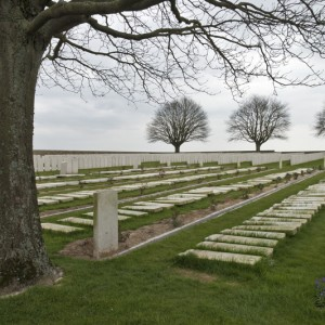 Gravestones being reset by the Commonwealth War Graves Commission at Grove Town Cemetery, Meaulte, Somme
